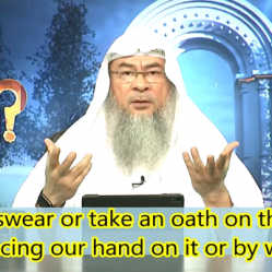 Can we swear or take an oath on Quran by placing our hand or by words?